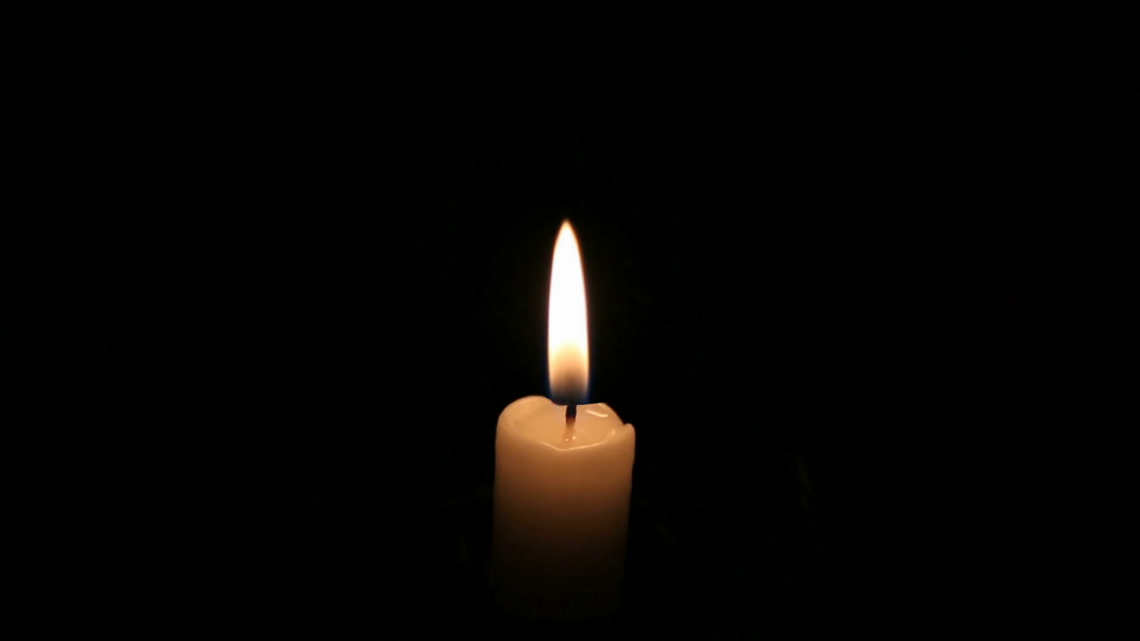 burning-candle-in-the-dark